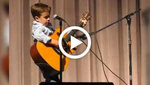 2nd grader pulls out guitar onstage, brings house down with rendition of Johnny Cash classic
